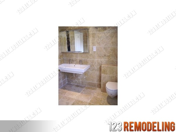 condo bathroom after remodel covered with stone tile