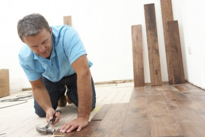 Worker Laying Wooden Flooring