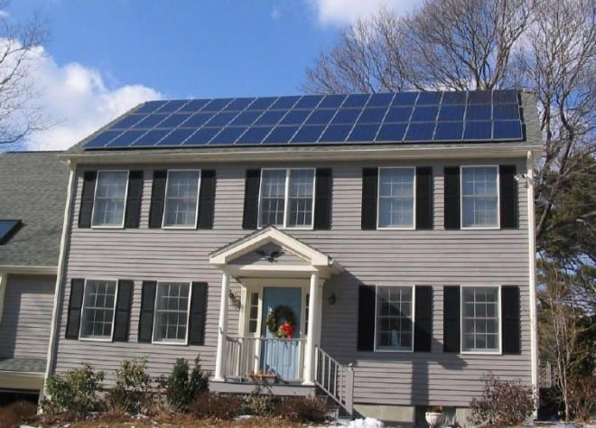 Solar panels installed on the rooftop of a suburban home