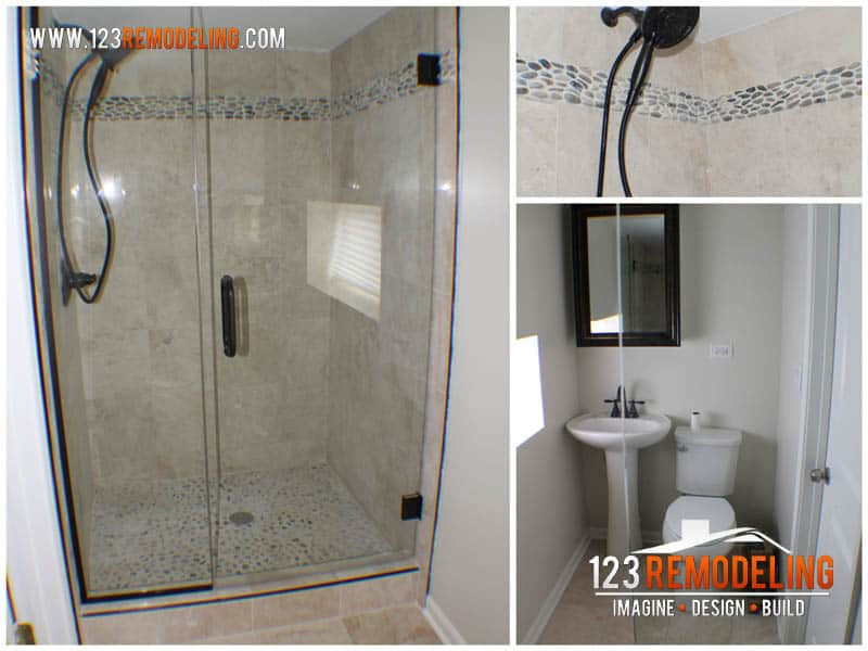 Tiny guest bathroom complete with walk-in shower. Mirror with built-in storage and pedestal vanity.