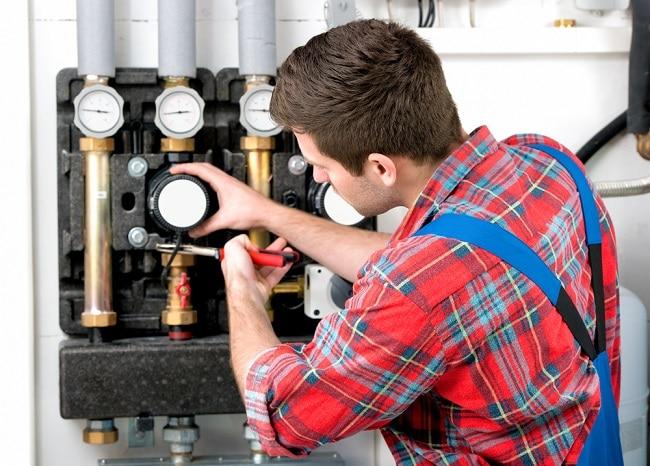 Gas Heating System Installer At Work