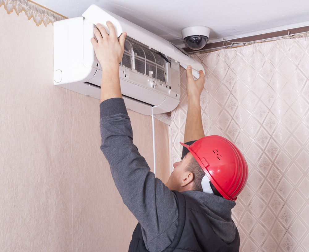 Repair-Man Servicing A/C Unit