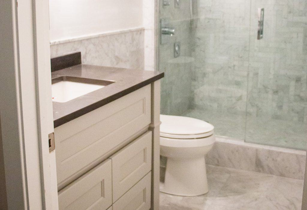 A modern bathroom with all marble tile