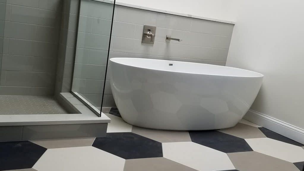 freestanding tub and hexagon tile flooring