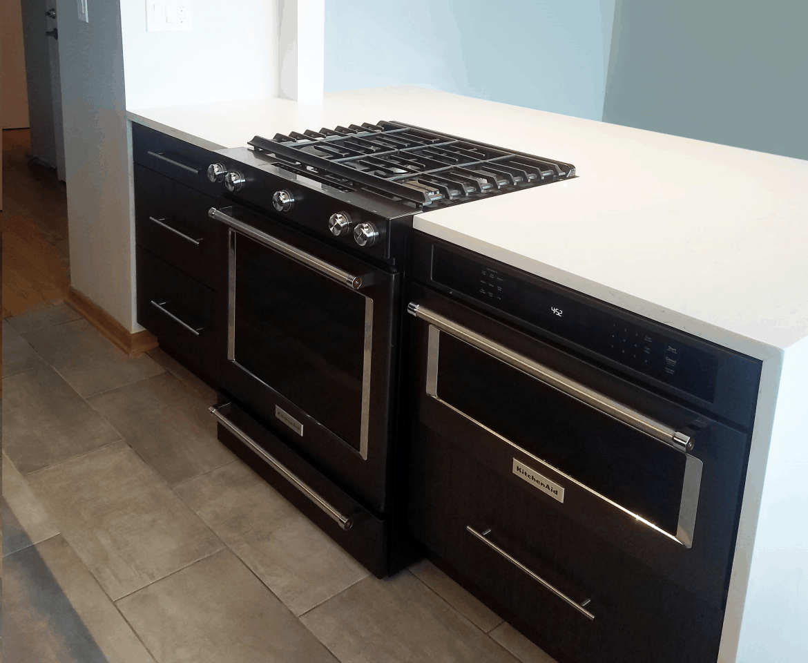black kitchen cabinetry and appliances