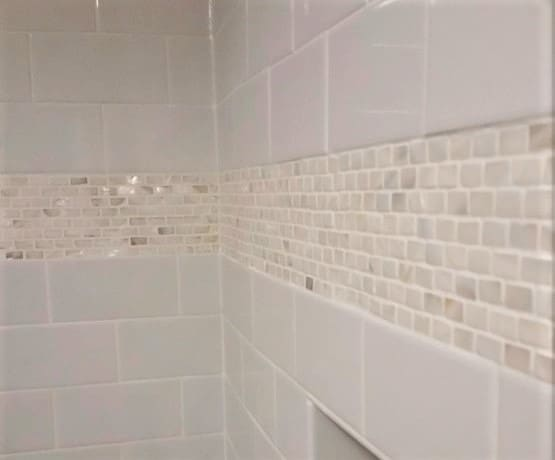 white shower wall with mother of pearl accent