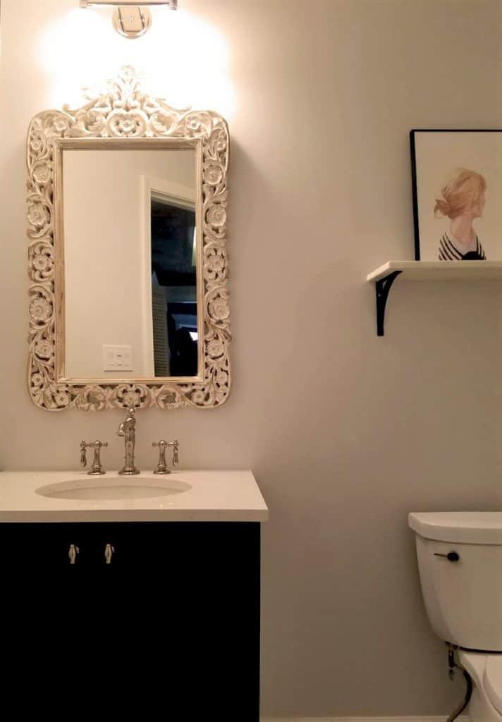 classic small bathroom with ornament mirror