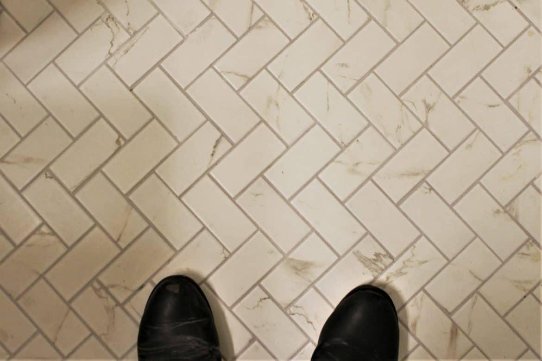 marble subway tile floor with herringbone layout