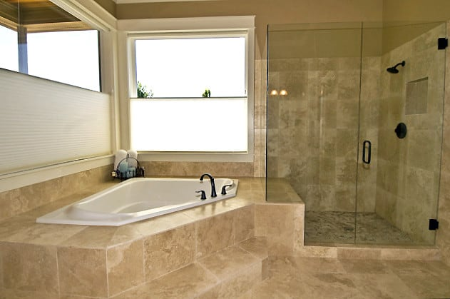 travertine tiled bathroom with tub and shower
